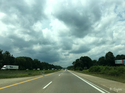 July 29, 2019 Driving under skies filling with clouds.