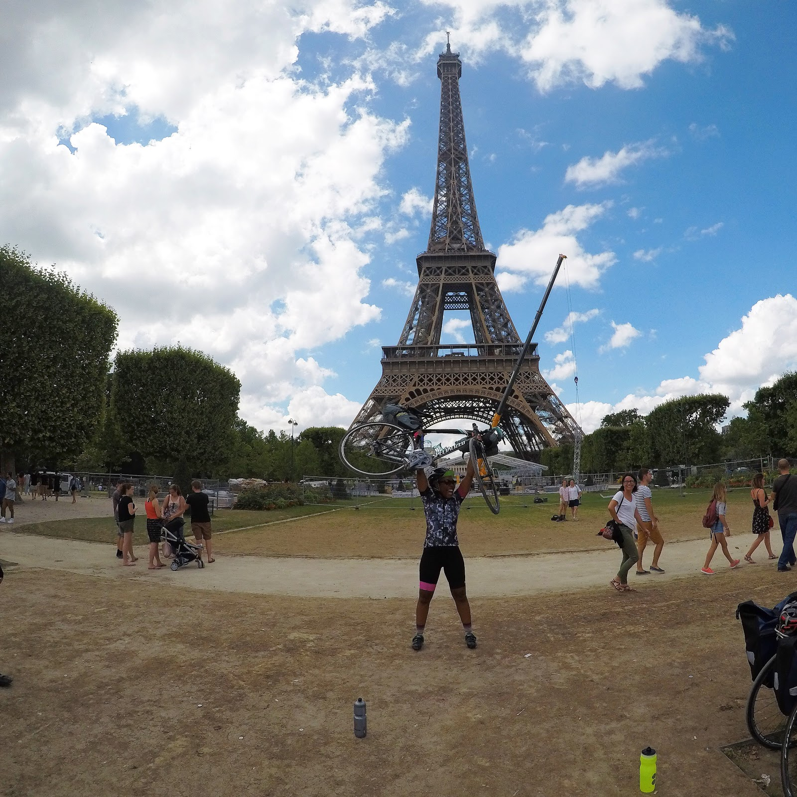holding bike in front of Eiffel tower after LONDON TO PARIS