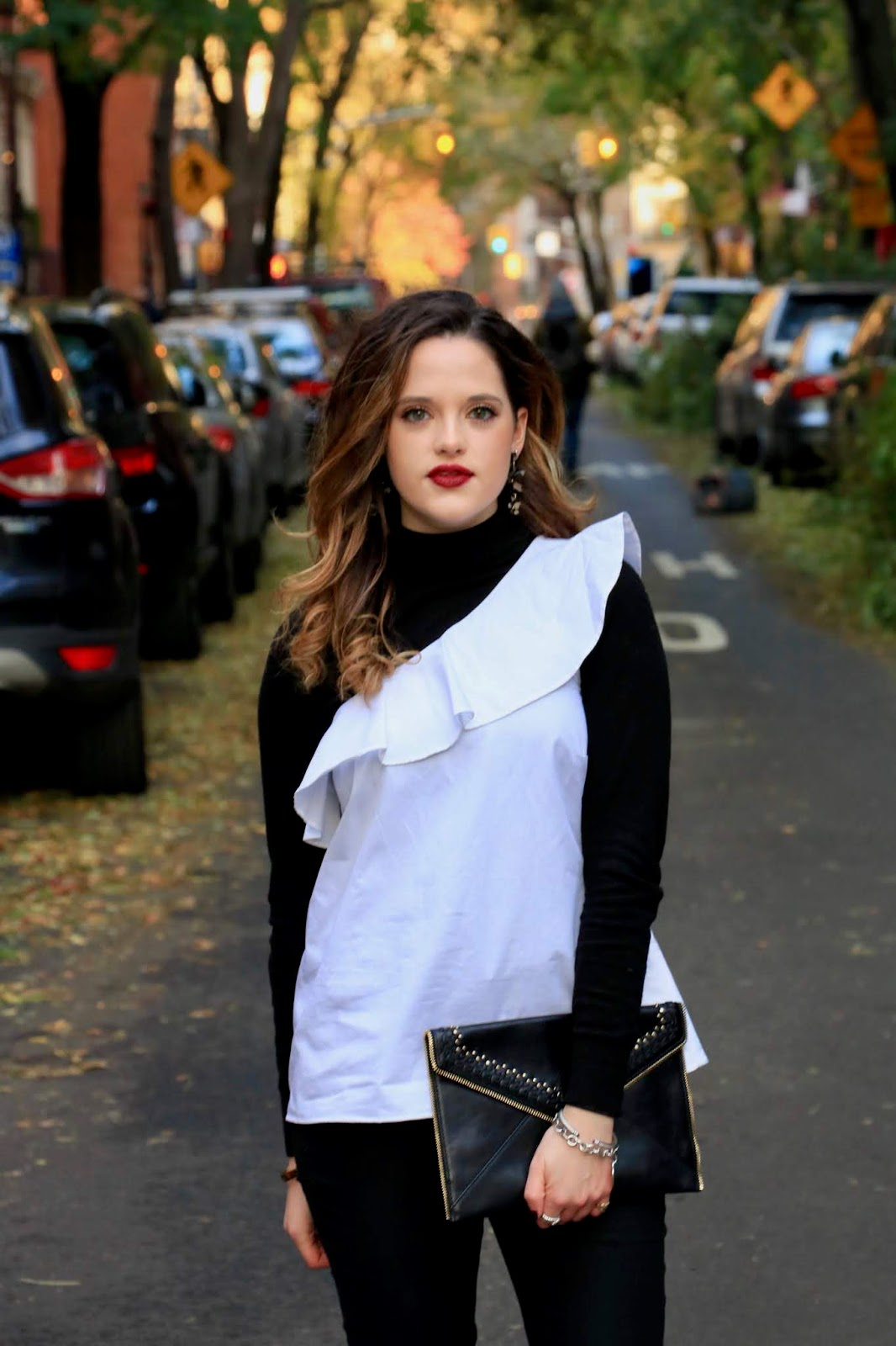 Nyc fashion blogger Kathleen Harper wearing a turtleneck layered under a blouse
