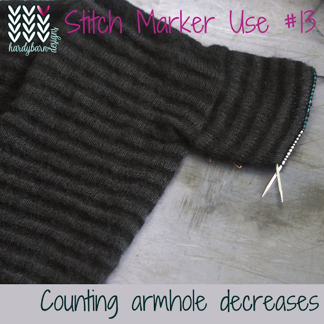 black striped cardigan with part knitted sleeve and markers attached