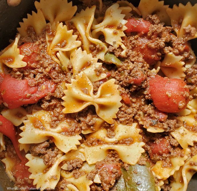 this is bow tie pasta served with venison bolognese sauce poured over the top