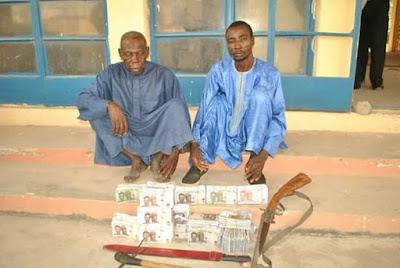 Photo: Police arrest two over possession of fake currency in Niger State; recover firearm, N8m suspected to be counterfeit