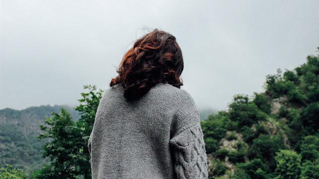 woman wearing cardigan, rear view Photo by Teymur Gahramanov on Unsplash