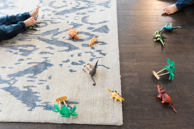little toes and dinosaur on the rug