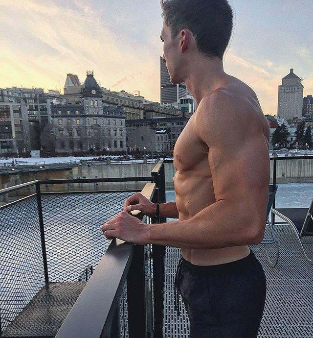 shirtless-muscular-guy-abs-enjoying-incredible-city-view