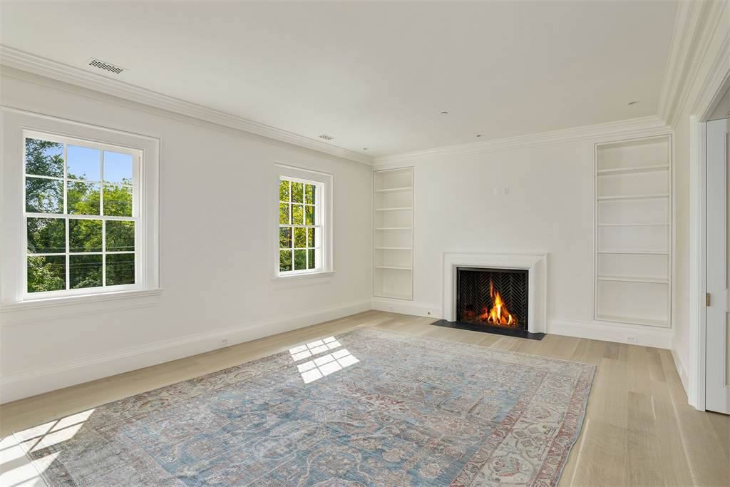 Inside Washington DC luxury mansion Kalorama fireplace regency style limestone
