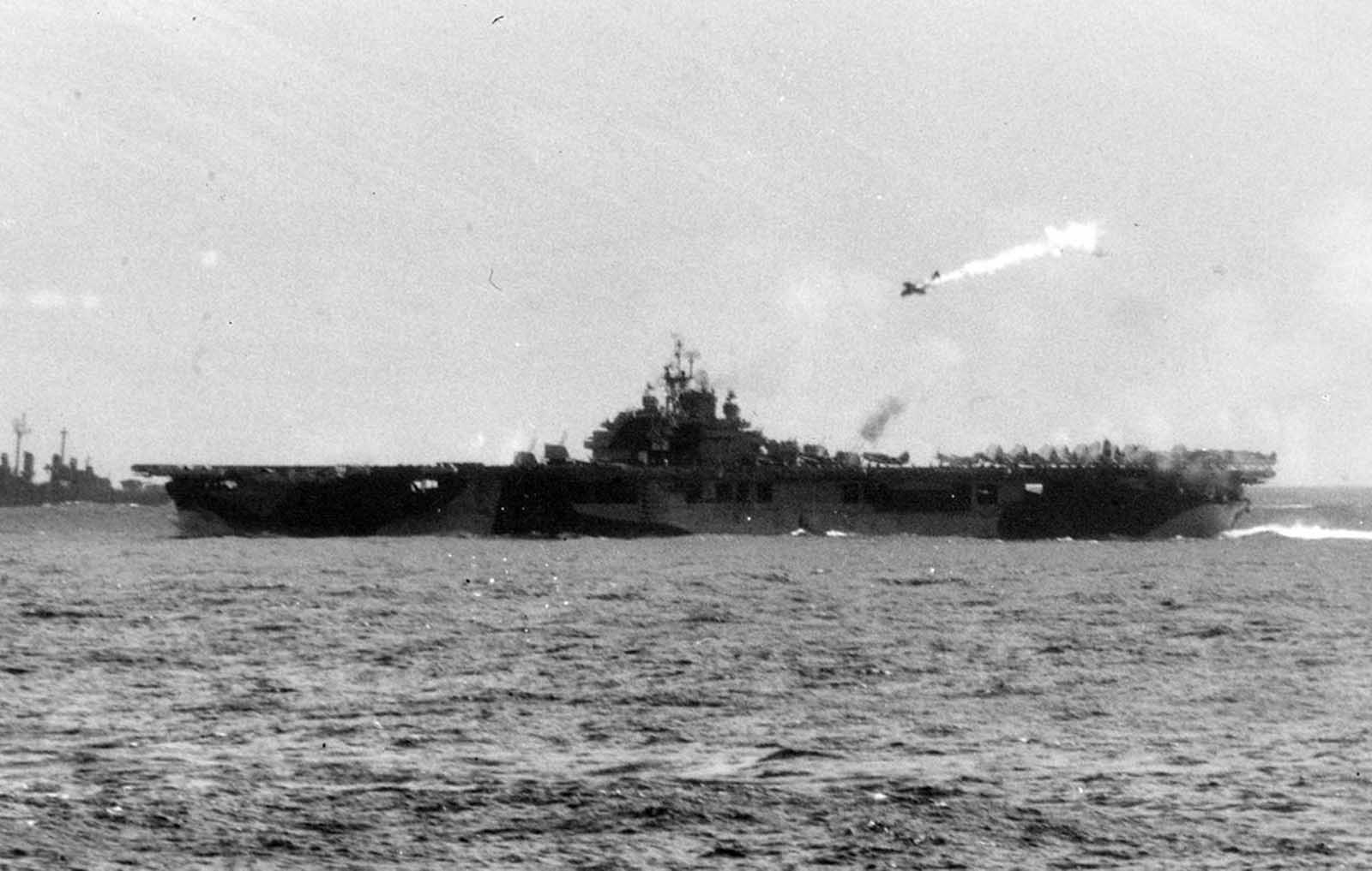 A Japanese kamikaze pilot in a damaged single-engine bomber, moments before striking the U.S. Aircraft Carrier USS Essex, off the Philippine Islands, on November 25, 1944.