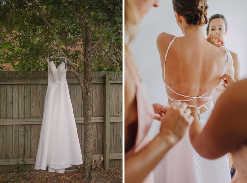 hanging bridal dress in tree