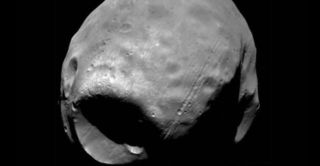 Lawrence Livermore National Laboratory researchers have demonstrated for the first time how an asteroid or comet could have caused the mega crater on Phobos without completely destroying the Martian moon.