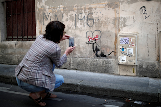 https://nypost.com/2018/06/26/banksy-takes-the-streets-of-paris/slide-8/