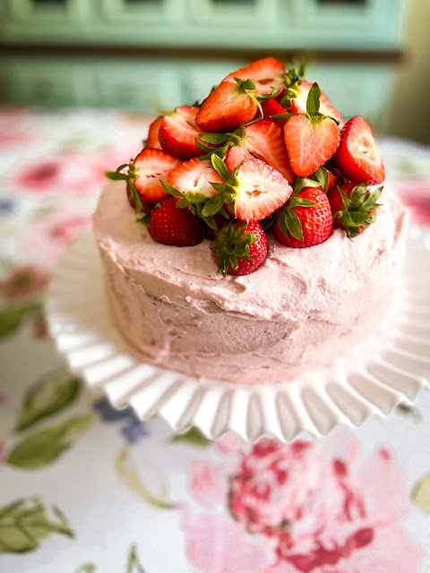 Fresh Strawberry Cake with Strawberry Buttercream Frosting, the ultimate Southern dessert for any special occasion, or just for a delightful dinner with family.  Fresh juicy strawberries take center stage in this show-stopping strawberry cake and buttercream frosting.
