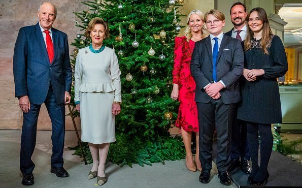 Princess Ingrid Alexandra wore a plated satin dress from Maje. Crown Princess Mette-Marit wore a pink patterned silk midi dress from H&M
