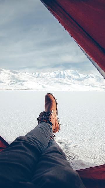 خلفية هاتف تصوير خيمه وسط الثلوج