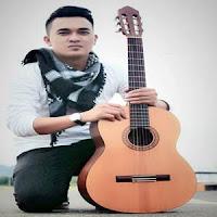 Lirik Lagu Minang Andri Dharma - Denai Tarimo