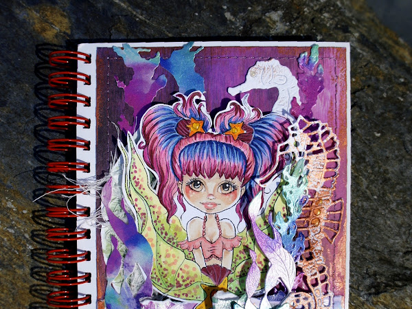 "A layered notebook cover with ""Mermaid Tails Coco"""