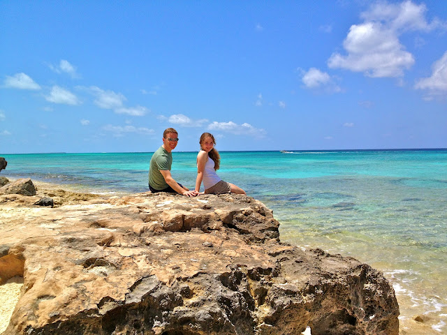 Father and daughter on the rocky beach of Grand Turk