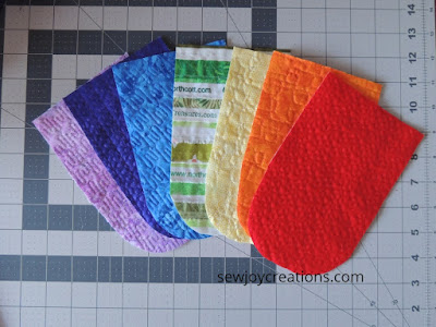quilted banner sections rainbow free motion quilting samples