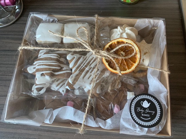 Christmas themed treat box with biscotti, Christmas cake, mince pies and more