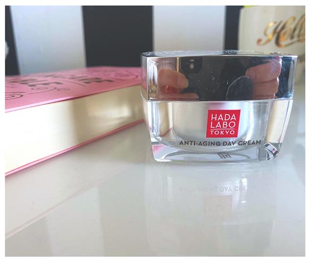 Tub of Hada Labo Day Cream next to Skincare Book