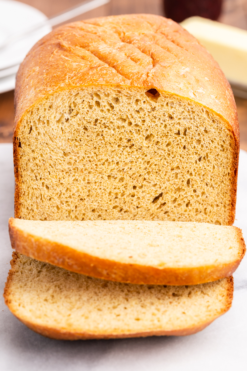 Closeup photo of a loaf of keto bread with 2 slices cut.