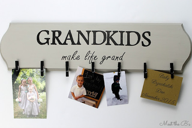 "Pregnancy Announcement Idea: ""Grandkids make life grand"" sign"