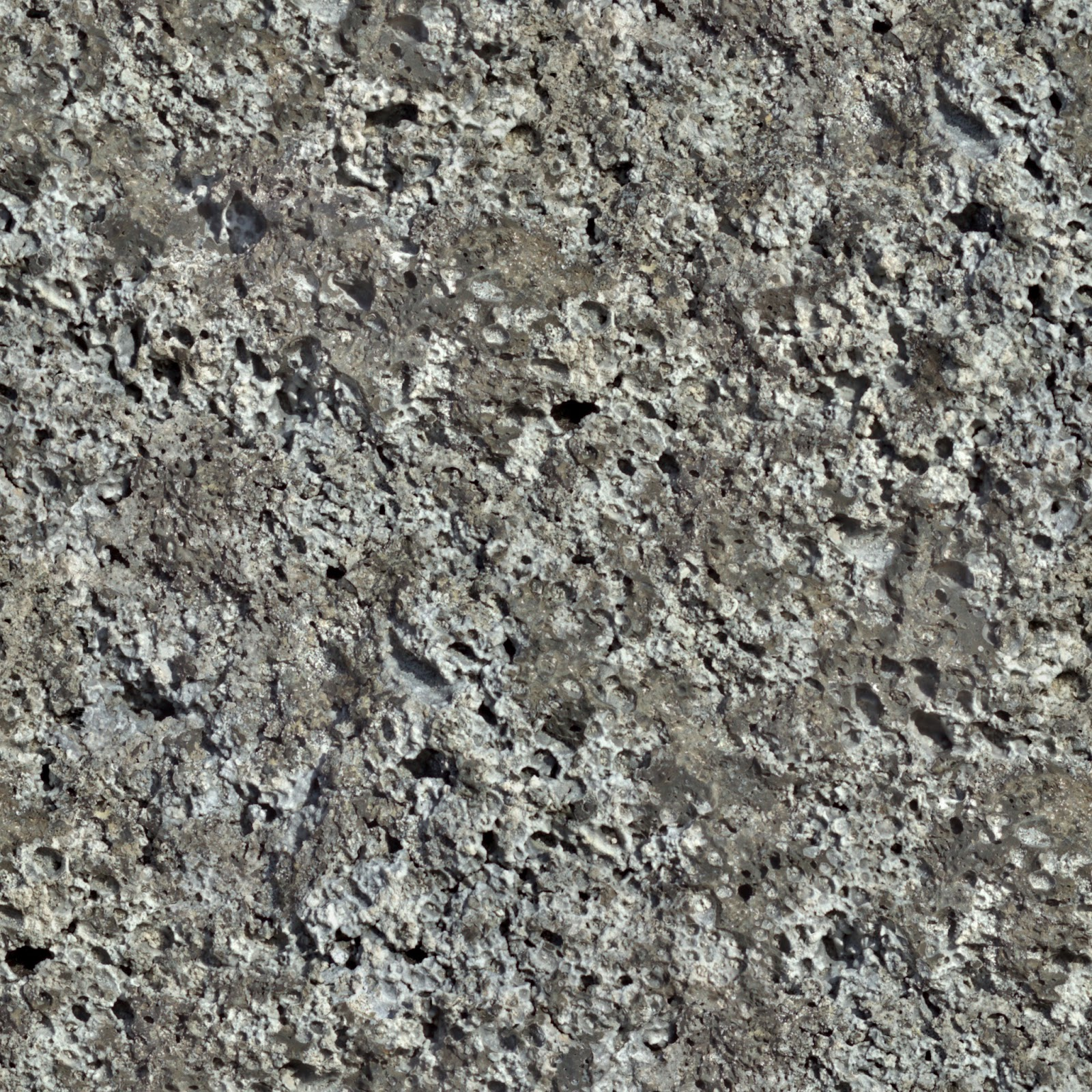 Rock face pitted seamless texture 2048x2048