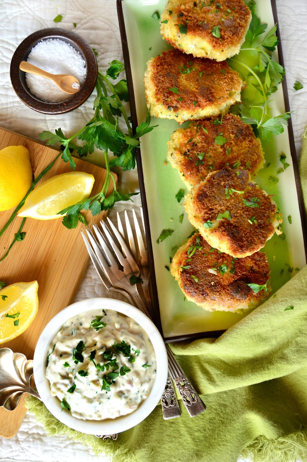 Irish Fish Cakes are savory cakes made with milk simmered cod and mashed potatoes. One might think these are entirely made of fish because of their flakey soft interiors.  Topped with a simply homemade tartar sauce, these are a winner in my book! #seafood #Irishfood #fishcakes #tartarsauce www.thisishowicook.com