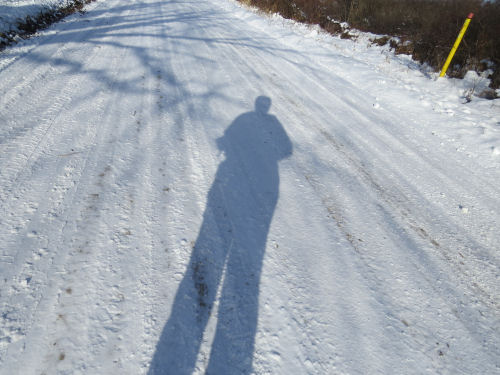 shadow of hiker on snow