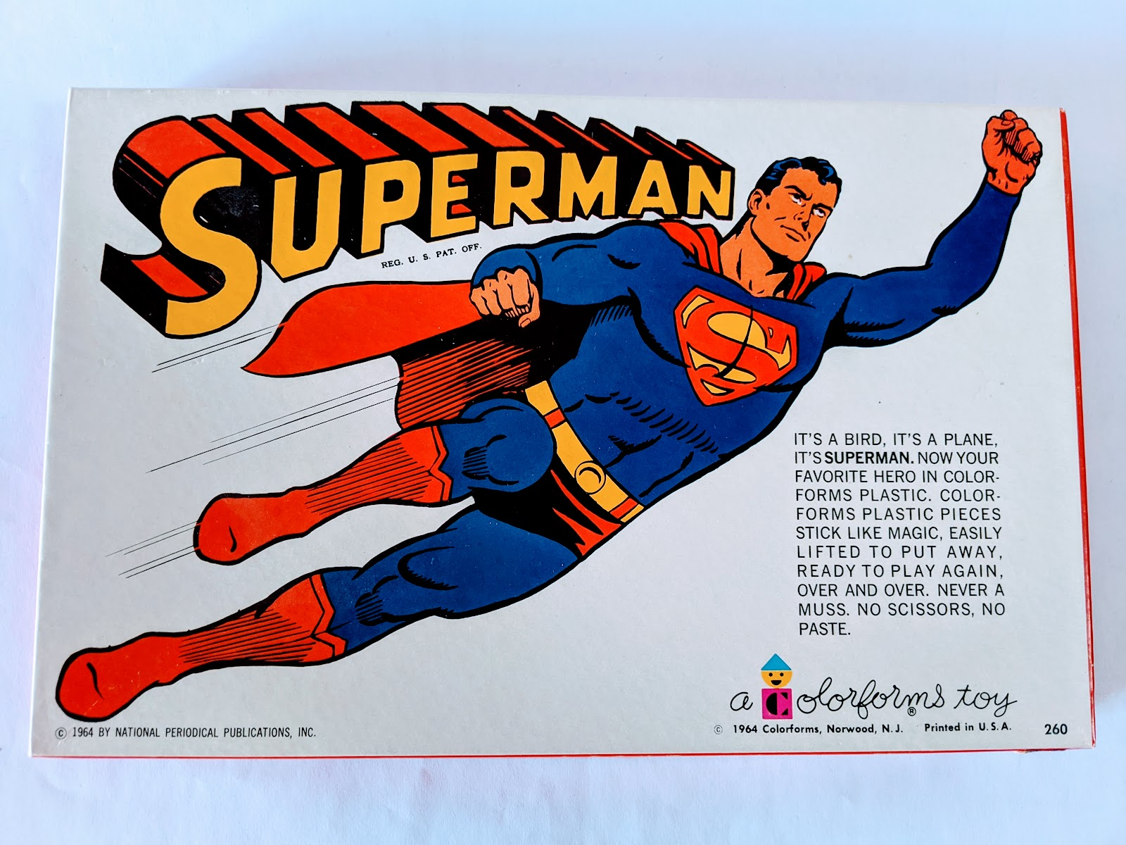 Picture of a vintage superman toy in the box from the 1960s