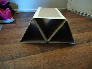 three completed cardboard triangles attached to each other