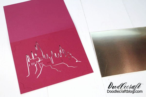 Okay, I don't have a lot of pictures for this process. Here's what I did. Just open up Cricut Design Space. Create a new canvas and then select the images tab.  Step 1: Search 'insert cards'. Step 2: Find an insert card that is blank that you like the corners of. Step 3: Insert Hogwarts Castle. Step 4: Attach the insert card and castle file, so it cuts it all out at once. Step 5:  Insert paper on the mat. Add your scoring wheel or stylus in the machine. The machine will score the card center line first. Step 6: Switch to the Cutting Blade and click go. Then the machine will cut out the notches and design. Step 7: Carefully remove card and insert metallic card cut to the proper size.