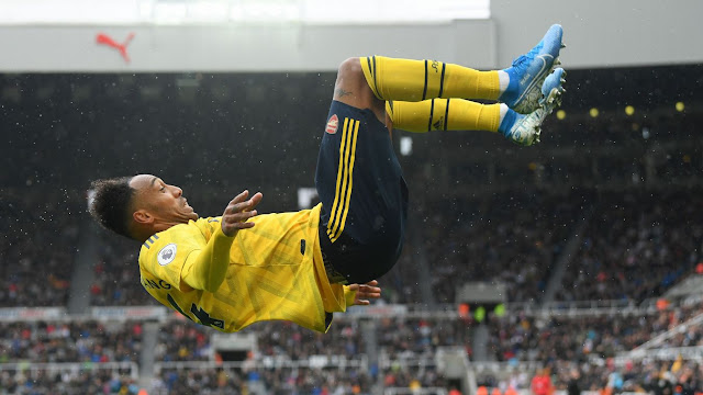 Pierre-Emerick Aubameyang acrobatically celebrates putting Arsenal 1-0 up at St James' Park during a Premier League match