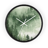 A clock with a picture of misty mountains on it.