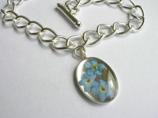 Sterling silver bracelet charm for flowers