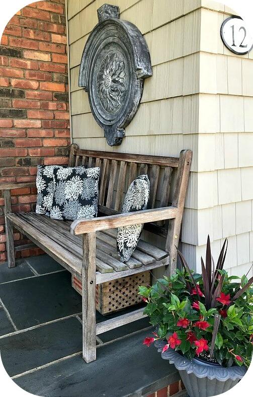 teak bench on front porch