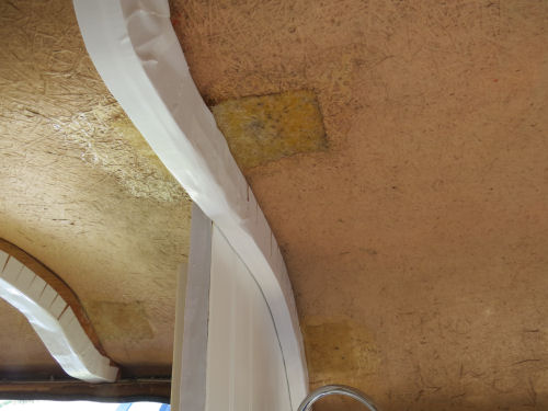 white tape used as trim inside a trailer