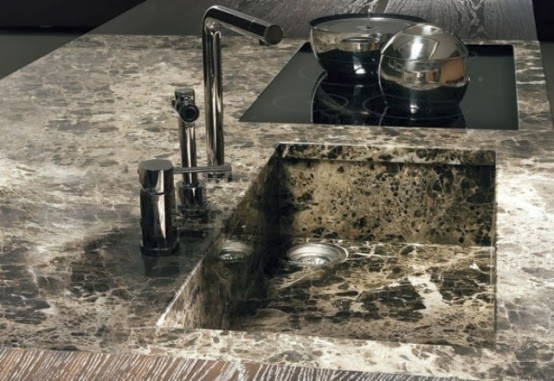 the marble covers the part around the sink as water could be ruinous for wood