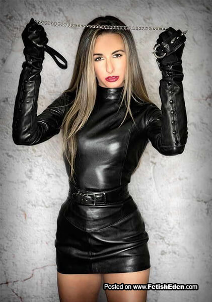 Leash Mistress in black leather mini-dress with black leather gloves