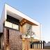 Fachada de casa com volumetria destacada por pedra ferro e cores semelhantes!