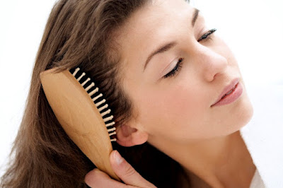 Brushing hair for healthy growth