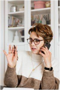 Woman talking on the phone with a confused expression