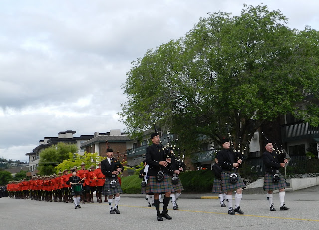 the Pipe Band leads the RCMP parade down Battle Street in Kamloops.