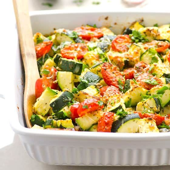Healthy Zucchini Tomato Casserole with garlic and Parmesan in 5 minutes of prep. Serve as low carb side dish or add cooked chicken for a 30 minute dinner.