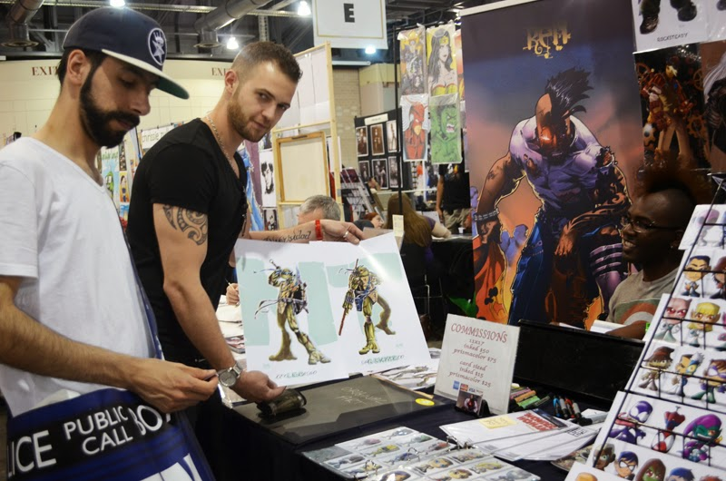 Two friends wait to get their comic prints signed at Wizard World Philadelphia 2014