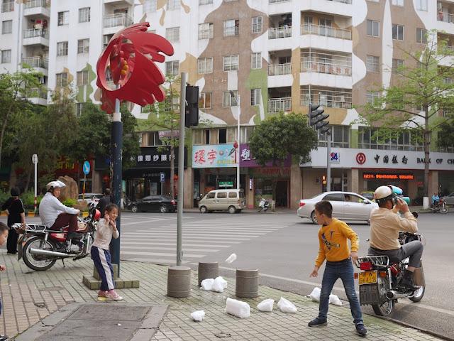kids throwing chunks of ice in Yunfu, Guangdong