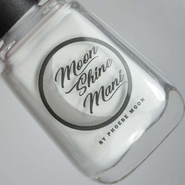 light grey nail polish in a bottle