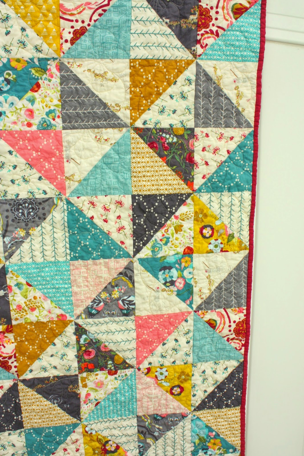 This image has an empty alt attribute; its file name is broken-dishes-baby-quilt.JPG