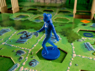One of the children races through the graveyard in the Goosebumps Terror in the Graveyard board game.
