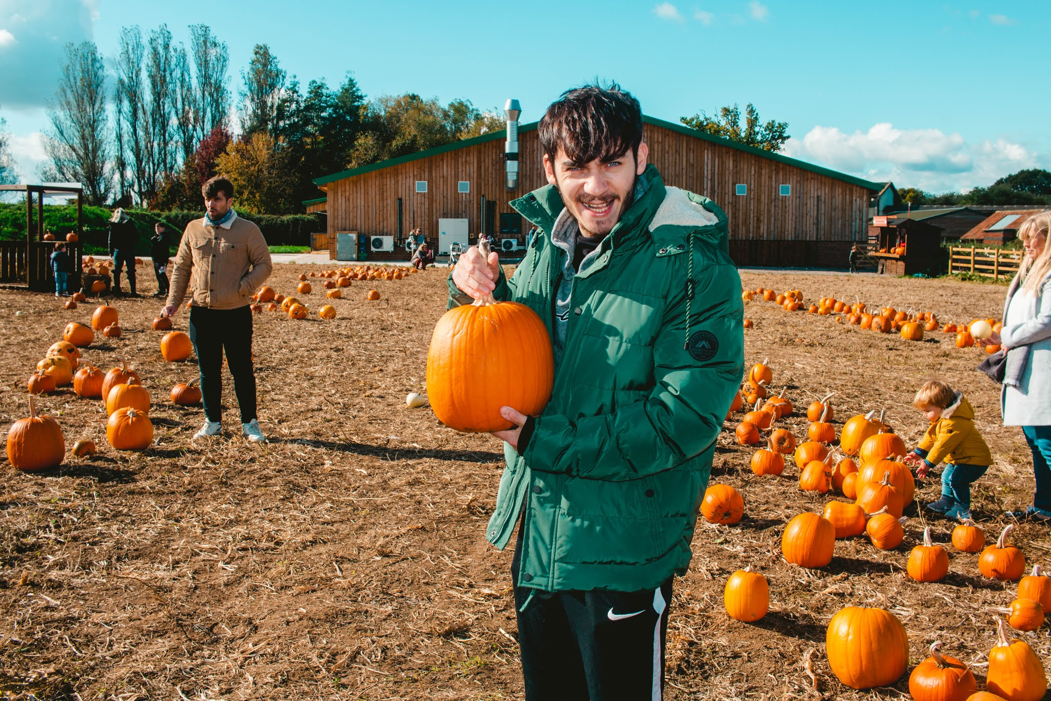 Guy with Autumn Pumpkins at Pumpkin Patch from Fall Pumpkin Picking Autumn Activities Blog Post