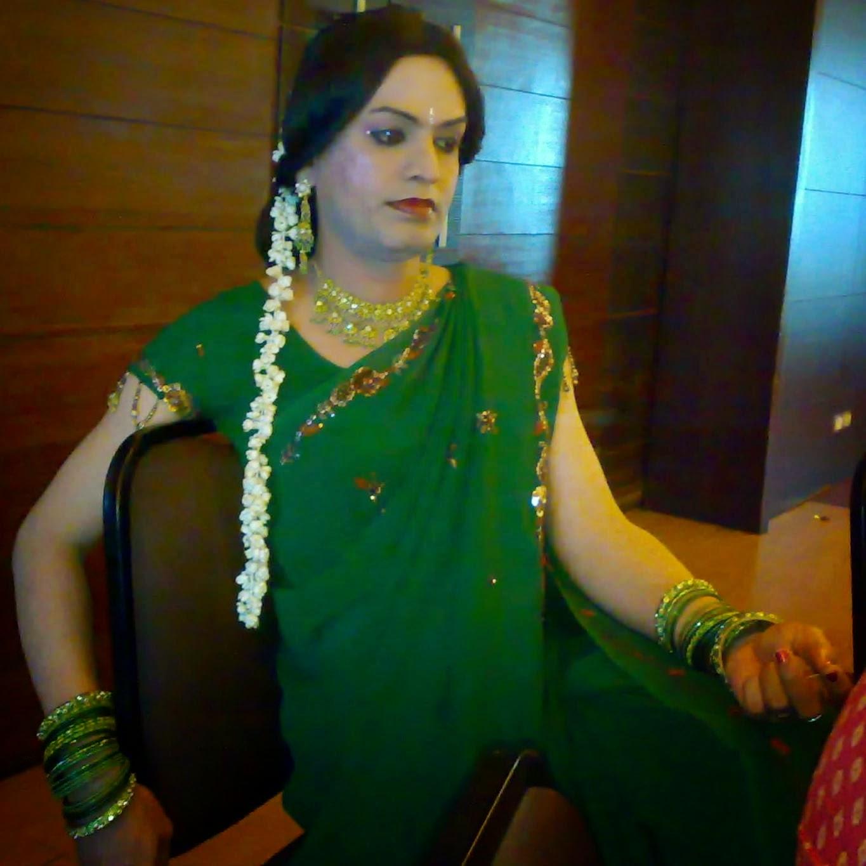 boy wearing green saree